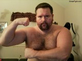 massively large burly daddybear flexing arms.jpg