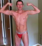 twinky slender muscleboy flexing lanky arms.jpg