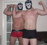 young tagteam pro wrestlers flexing biceps.jpg