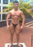 oriental bodybuilder weightlifter big muscles.jpg