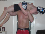 chunky masked wrestlers lifting opponents backbreakers.jpg