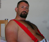 a hairy manly bear wearing red suspenders.jpg