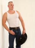 a ruggedly masculine handsome cowboy man tanktop.jpg