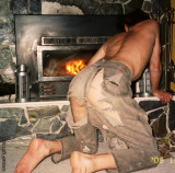 redneck stoking fire ripped torn jeans ass showing.jpg