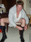 redhead wrestler tieing shoes leather boots photos.jpg