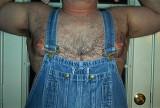 burly bear daddy wearing coveralls huge pecs.jpg