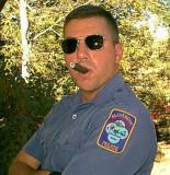 policeman smoking cigar state cop officer.jpg