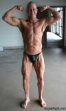 ripped muscular bodybuilder flexing precontest photos.jpg