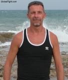 goatee man wearing tanktop ocean beachfront.jpg