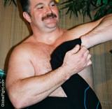 a big arms musclebear daddy undressing.jpg