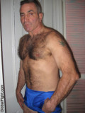 a crewcut flat top hairy daddy muscledude arms.jpg
