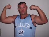 a muscleman flexing big biceps hairyarmpits pics.jpg