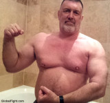 bearded gay burly dad flexing pics.jpg