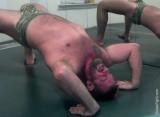 bigbear doing stretching exercises gay club gym.jpg