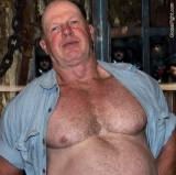 caged daddy bdsm prisoner fighter opened shirt.jpg
