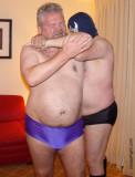 figure four necklock daddy wrestling hotel room.jpg