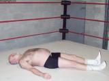 grandaddy flat on back boxing ring knocked down.jpg
