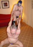 heavyset bears fat gray moustache hotel room wrestling.jpg