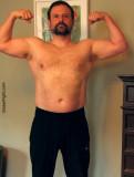 huge bearded muscledaddy double biceps flexing pics.jpg