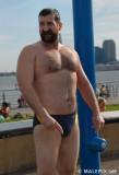 man at beach shirtless wet hairychest glistening muscles.jpg
