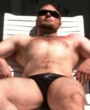 hunky irish boy suntanning poolside hirsute guy.jpg