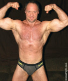 muscledaddy flexing huge biceps massive hairy arms.jpg