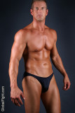 very handsome muscular bodybuilder posing smooth chest.jpg