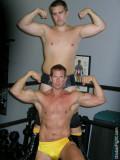 wrestling musclemen pro wrestlers flexing muscles.jpg