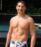 musclestud lounging poolside gay party photos.jpg