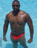 super hot black man swimming glistening ebony muscles.jpg