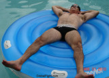 very hairylegs furry man swimming pool rafting suntanning.jpg