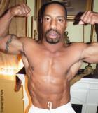 black musclemen flexing huge manly biceps muscles.jpg