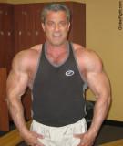 huge massive bodybuilders posing delts biceps arms pics.jpg