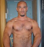 shaved head bald mans musclejock solid pecs.jpg