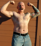 cigar pig leather daddy flexing double biceps big arms.jpg