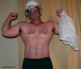 man wearing footbal helmet undressing removed jersey.jpg