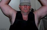 police man wearing bullet proof vest flexing muscles.jpg
