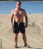 hot hunky bearish man beach ocean resort suntanning pics.jpg