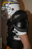 slender football player wearing gear helmet spandex.jpg