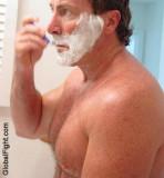 very big tough hunky hairychest dude shaving locker room.jpg