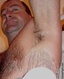 very hairy man showering rinsing off armpits.jpg