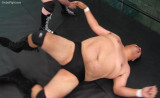 big heavyweight pro wrestlers knocked down floor out cold.jpg