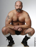 beefy balding bearded man tattooed hairychest leather boots wrestler.jpg