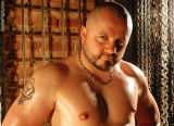big muscular gay leather daddy hunky hot man dungeon bdsm.jpg