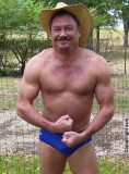 muscular redneck guy flexing arms muscles hairychest.jpg