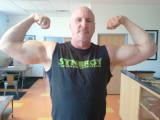 balding hot silverdaddie muscleman flexing huge thick bicep arms.jpg