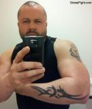 tattooed leather daddie wearing vest wrist straps pictures.jpg