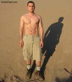 gay man standing desert beach sandpit sweaty hiking pics.jpg