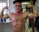 silverdaddie flexing big guns flexed biceps pictures.jpg