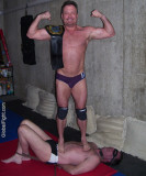 man standing on his opponent hunky grapplers.jpg
